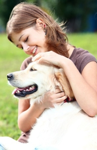10576186 - woman playing with her dog outdoors