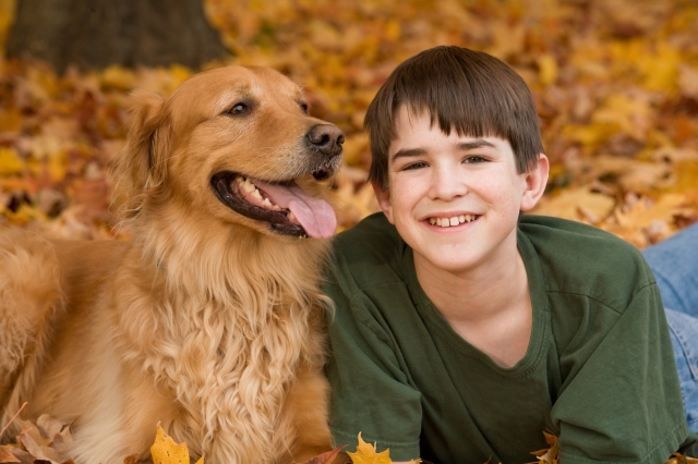 Teenager with Golden Retriever in the Fall